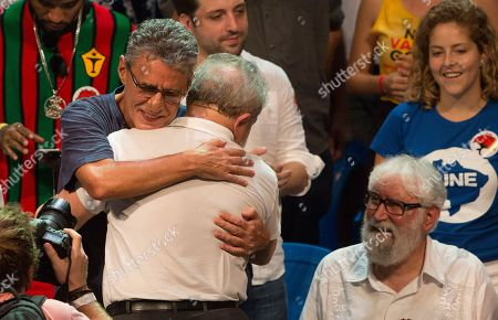 Luiz Inacio Lula da Silva, Chico Buarque Brazil's former President Luiz Inacio Lula da Silva hugs Brazilian singer Chico Buarque, left, during a gathering with artists and intellectuals in support of Brazil's President Dilma Rousseff, in Rio de Janeiro, Brazil, . A congressional committee voted Monday to recommend that the impeachment process against President Dilma Rousseff move forward, bringing the possible ouster of the embattled leader a step closer