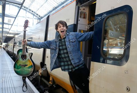 Stock Image of Champion London busker Alex James Ellison poses for the media on a Eurostar train at London St Pancras International terminal, . Alex will travel to Paris on Tuesday to promote London's busking talent after being awarded the Eurostar Prize in last year's Gigs competition
