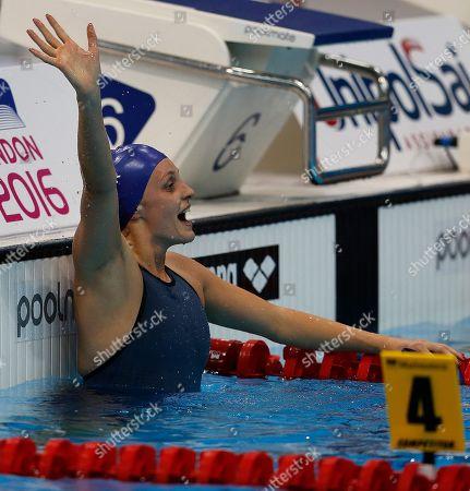 Britain's Francesca Halsall reacts after winning the Women's 50m Backstroke final at the European Aquatics Championships in London