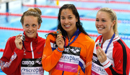 Winner Ranomi Kromowidjojo of the Netherlands, centre, Francesca Halsall of Britain, second placed, left, and Jeanette Ottesen of Denmark, third placed, right, pose with their medals after the women's 50m freestyle final at the European Aquatics Championships in London