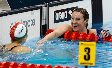 Britain's Jazmin Carlin, right, congratulates gold medal winner Hungary's Boglarka Kapas, left, after the women's 800-meter freestyle final during the European Swimming Championships at the London Aquatics Centre in London
