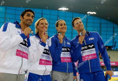 Italy's, from left, Filippo Magnini, Federica Pellegrini, Erika Ferraioli and Luca Dotto show off their silver medals after the mixed 4x100-meter freestyle relay during the European Swimming Championships at the London Aquatics Centre in London