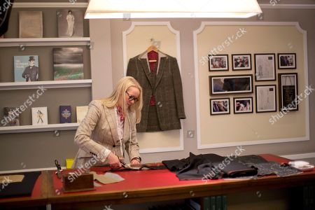 Kathryn Sargent Kathryn Sargent who is the first female master tailor and head cutter to open a store on Savile Row, London's traditional street of bespoke men's tailoring, poses for photographers in the store, . The tailoring house, which is number 37 Savile Row, opens to the public today