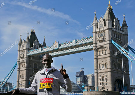Kenya's Wilson Kipsang poses for photographers ahead of the London marathon at the Tower Bridge in London, . The London marathon will take place on Sunday