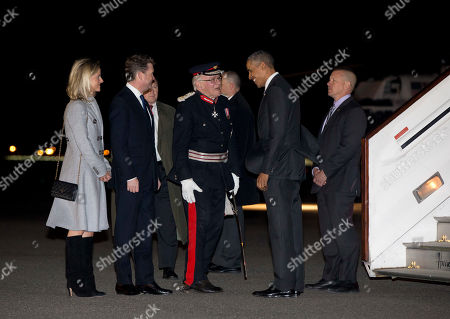 Stock Photo of Barack Obama, Lord Petre, Matthew Barzun, Brooke Barzun U.S. President Barack Obama is greeted by The Lord Petre, Her Majesty's Lord-Lieutenant of Essex; U.S. Ambassador to the United Kingdom Matthew Barzun and his wife, Brooke Barzun, second from left, as he arrives on Air Force One at London Stansted Airport in Stansted, England