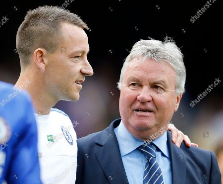 John Terry, Guus Hiddink Chelsea's John Terry, left, speaks to Chelsea manager Guus Hiddink after the English Premier League soccer match between Chelsea and Leicester City at Stamford Bridge stadium in London