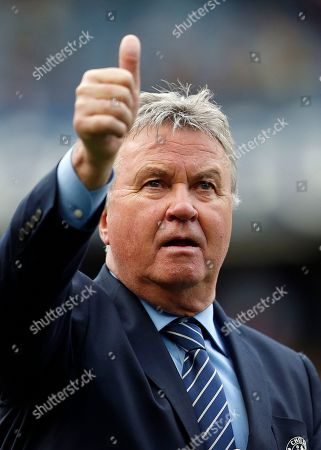 Guus Hiddink Chelsea manager Guus Hiddink shows a thumb up after the English Premier League soccer match between Chelsea and Leicester City at Stamford Bridge stadium in London