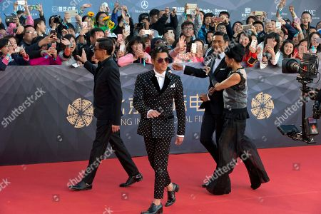 Chow Yun-fat, Jasmine Tan, Aaron Kwok, Tony Leung Ka-fai Hong Kong actors from right Chow Yun-fat with his wife Jasmine Tan, Aaron Kwok and Tony Leung Ka-fai arrive at the red carpet for the 6th Beijing International Film Festival held on the outskirts of Beijing, China