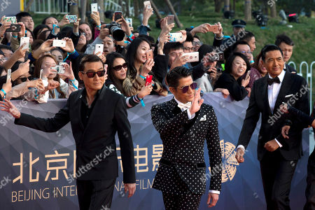 Chow Yun-fat, Aaron Kwok, Tony Leung Ka-fai Hong Kong actors from right Chow Yun-fat, Aaron Kwok and Tony Leung Ka-fai arrive at the red carpet for the 6th Beijing International Film Festival held on the outskirts of Beijing, China