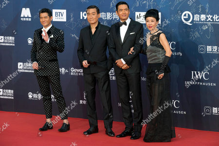 Chow Yun-fat, Jasmine Tan, Aaron Kwok, Tony Leung Ka-fai Hong Kong actors from right Chow Yun-fat with his wife Jasmine Tan, Aaron Kwok and Tony Leung Ka-fai pose for photos at the red carpet for the 6th Beijing International Film Festival held on the outskirts of Beijing, China
