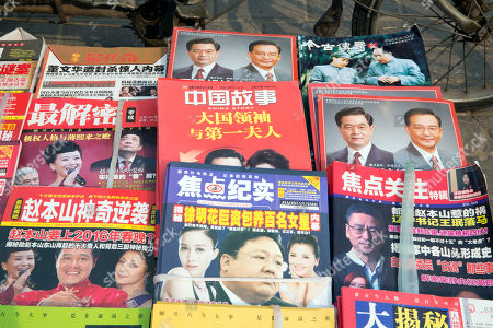 Chinese magazines featuring former Chinese President Hu Jintao and former Chinese Premier Wen Jiabao are displayed at a newsstand in Beijing, China, . Previous reports by international media on the personal finances of Chinese leaders have drawn retaliation from Beijing, frequently through the blocking of media websites and a refusal to issue visas to their journalists