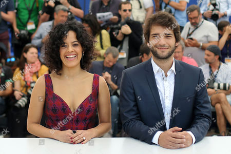 CAPTION CORRECTS ACTOR'S NAME TO HUMBERTO CARRAO Actress Maeve Jinkings, left and actor Humberto Carrao pose for photographers during a photo call for the film Aquarius at the 69th international film festival, Cannes, southern France