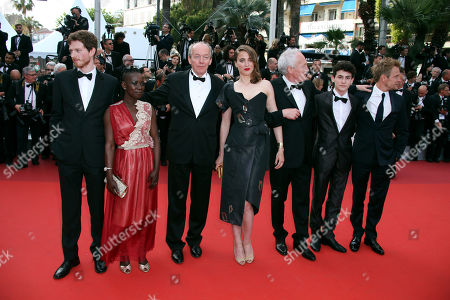 Actors Olivier Bonnaud, Nadege Ouedraogo, director Luc Dardenne, Adel Haenel, director Jean-Pierre Dardenne, Louka Minnella and Jeremie Renier, from left, pose for photographers upon arrival at the screening of the film La Fille Inconnue (The Unkown Girl) at the 69th international film festival, Cannes, southern France