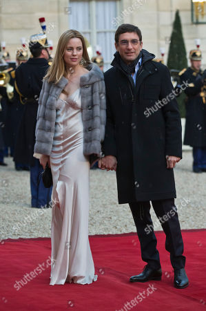 Australian actress Melissa Geroge, left, and Jean David Blanc arrive for a dinner with French President Francois Hollande and Australian Governor-General Peter Cosgrove at the Elysee Palace in Paris, France