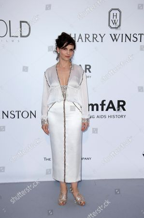 Stock Photo of Actress Juliet Binoche poses for photographers upon arrival for the amfAR Cinema Against AIDS benefit at the Hotel du Cap-Eden-Roc, during the 69th Cannes international film festival, Cap d'Antibes, southern France