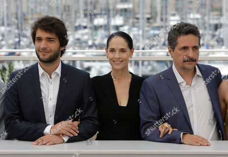 Actor Humberto Carrao, actress Sonia Braga and director Kleber Mendonca Filho, from left, pose for photographers during a photo call for the film Aquarius at the 69th international film festival, Cannes, southern France