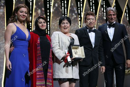 Actress Jaclyn Jose, centre, poses for photographers with actress Andi Eigenmann, Jury member Katayoon Shahabi, director Brillante Mendoza and Jury member Mads Mikkelsen, from left, after winning the Best Actress award for the film Ma' Rosa, at the awards ceremony at the 69th international film festival, Cannes, southern France