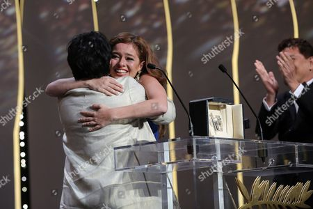 Actress Jaclyn Jose, left, hugs actress Andi Eigenmann, centre, after winning the Best Actress award for the film Ma' Rosa, at the awards ceremony at the 69th international film festival, Cannes, southern France