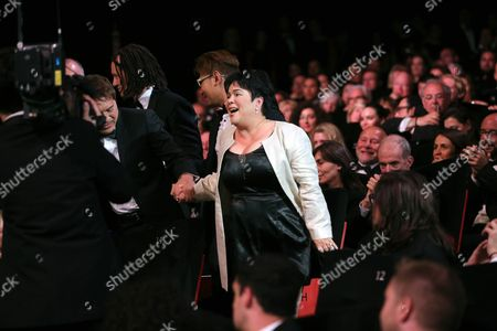 Actress Jaclyn Jose, centre, reacts after winning the Best Actress award for the film Ma' Rosa, at the awards ceremony at the 69th international film festival, Cannes, southern France