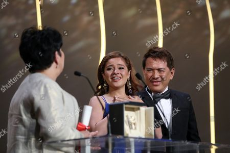 Actress Jaclyn Jose, left looks at actress Andi Eigenmann, centre and director Brillante Mendoza, after winning the Best Actress award for the film Ma' Rosa, at the awards ceremony at the 69th international film festival, Cannes, southern France
