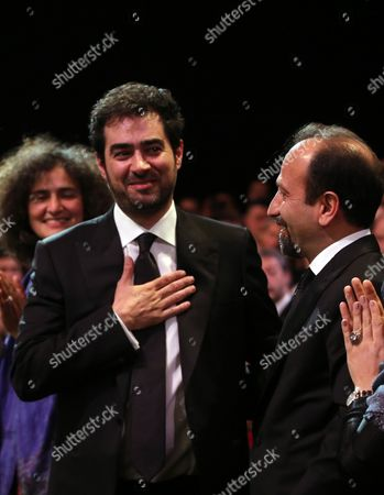 Actor Shahab Hosseini reacts after winning Best Actor award for the film Forushande, The Salesman, during the awards ceremony at the 69th international film festival, Cannes, southern France