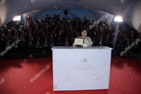 Actress Jaclyn Jose poses for photographers after winning the Best Actress award for the film Ma'Rosa, during the photo call following the awards ceremony at the 69th international film festival, Cannes, southern France