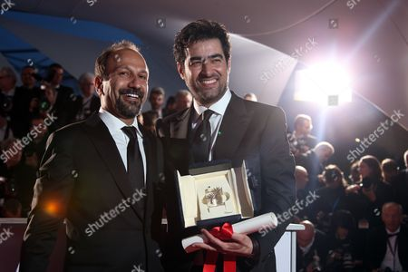 Actor Shahab Hosseini, right and director director Asghar Farhadi pose for photographers after Hosseini won the Best Actor award and Farhadi, the Best Screenplay award for the film Forushande (The Salesman), during the photo call following the awards ceremony at the 69th international film festival, Cannes, southern France