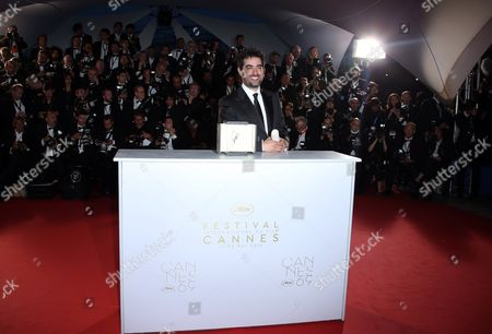 Actor Shahab Hosseini reacts after winning the Best Actor award for the film Forushande (The Salesman), during the photo call following the awards ceremony at the 69th international film festival, Cannes, southern France