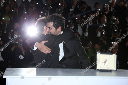 Actor Shahab Hosseini, right and director Asghar Farhadi pose for photographers after Hosseini won the Best Actor award and Farhadi, the Best Screenplay award for the film Forushande (The Salesman), during the photo call following the awards ceremony at the 69th international film festival, Cannes, southern France