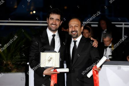 Actor Shahab Hosseini, left and director director Asghar Farhadi pose for photographers after Hosseini won the Best Actor award and Farhadi, the Best Screenplay award for the film Forushande (The Salesman), during the photo call following the awards ceremony at the 69th international film festival, Cannes, southern France