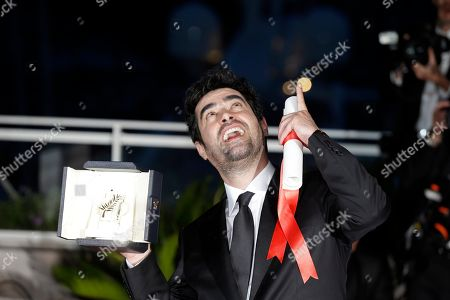 Actor Shahab Hosseini reacts after winning Best Actor award for the film Forushande, The Salesman, during the photo call following the awards ceremony at the 69th international film festival, Cannes, southern France