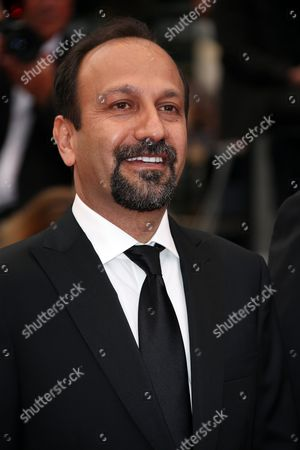 Director Ashgar Farhadi pose for photographers upon arrival at the awards ceremony for the 69th international film festival, Cannes, southern France