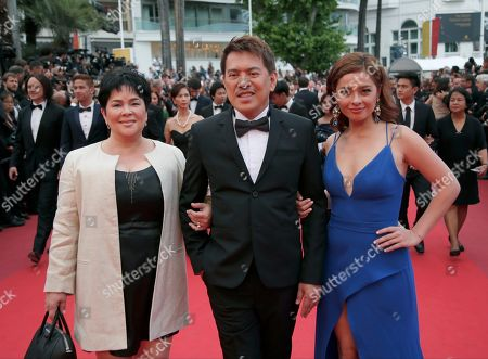 Actress Andi Eigenmann, director Brillante Mendoza and actress Jaclyn Jose, from right, pose for photographers upon arrival at the awards ceremony at the 69th international film festival, Cannes, southern France
