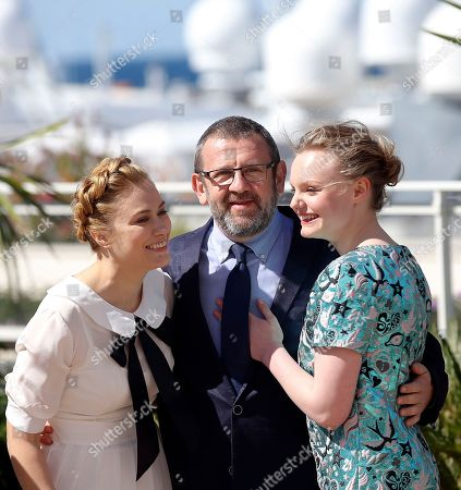 Actress Malina Manovici, director Cristian Mungiu and actress Maria Dragus, from left, pose for photographers during a photo call for the film Bacalaureat at the 69th international film festival, Cannes, southern France