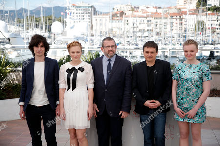 Stock Image of Actors Rares Andrici, Malina Manovici, Adrian Titieni, director Cristian Mungiu and Maria Dragus, from left, pose for photographers during a photo call for the film Bacalaureat at the 69th international film festival, Cannes, southern France