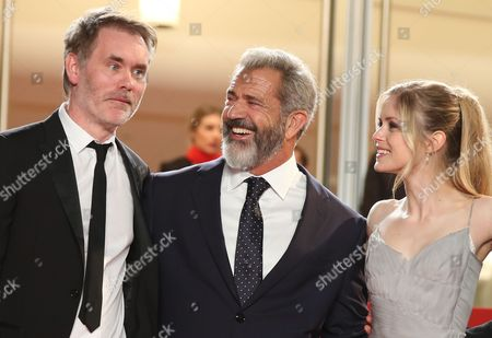 Jean Francois Richet, Mel Gibson, Erin Moriarty Director Jean Francois Richet, from left, actors Mel Gibson and Erin Moriarty pose for photographers upon arrival at the screening of the film Blood Father at the 69th international film festival, Cannes, southern France