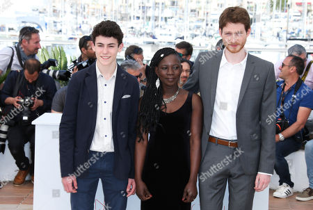 Actors Louka Minnella, Nadege Ouedraogo and Olivier Bonnaud, from left, pose for photographers during a photo call for the film La Fille Inconnue (The Unknown Girl) at the 69th international film festival, Cannes, southern France