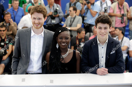 Actors Olivier Bonnaud, Nadege Ouedraogo and Louka Minnella, from left, pose for photographers during a photo call for the film La Fille Inconnue (The Unknown Girl) at the 69th international film festival, Cannes, southern France