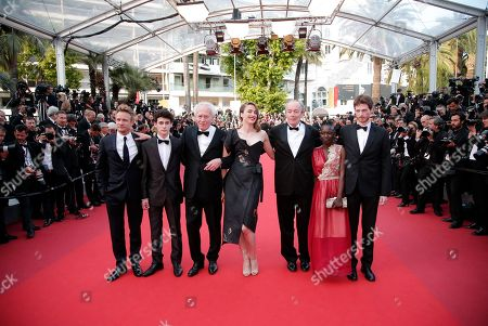 Actors Jeremie Renier, Louka Minnella, director Jean-Pierre Dardenne, Adele Haenel, director Luc Dardenne, Nadege Ouedraogo and Olivier Bonnaud, from left, pose for photographers upon arrival at the screening of the film La Fille Inconnue (The Unkown Girl) at the 69th international film festival, Cannes, southern France