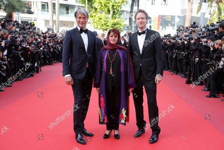 Jury members, Laszlo Nemes, Katayoon Shahabi and Mads Mikkelsen, from left, pose for photographers upon arrival at the screening of the film Loving at the 69th international film festival, Cannes, southern France