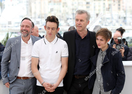 Actors Jean-Luc Vincent, Brandon Lavieville Director Bruno Dumont and actress Raph, from left, pose for photographers, during a photo call for the film Ma Loute (Slack Bay) at the 69th international film festival, Cannes, southern France
