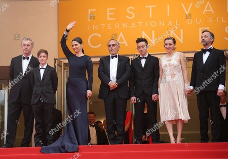 Director Bruno Dumont, left poses for photographers with from left, Raph, Juliette Binoche, Fabrice Luchini, Brandon Lavieville, Valeria Bruni Tedeschi, and Jean-Luc Vincent, upon arrival at the screening of the film Ma Loute (Slack Bay) at the 69th international film festival, Cannes, southern France