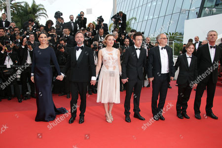 Actors from left, Juliette Binoche, Jean-Luc Vincent, Valeria Bruni Tedeschi, Brandon Lavieville, Fabrice Luchini, Raph and director Bruno Dumont pose for photographers upon arrival at the screening of the film Ma Loute (Slack Bay) at the 69th international film festival, Cannes, southern France