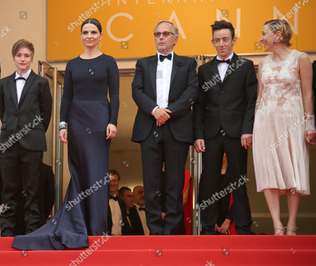 Actors from left, Raph, Juliette Binoche, Fabrice Luchini, Brandon Lavieville, and Valeria Bruni Tedeschi pose for photographers upon arrival at the screening of the film Ma Loute (Slack Bay) at the 69th international film festival, Cannes, southern France