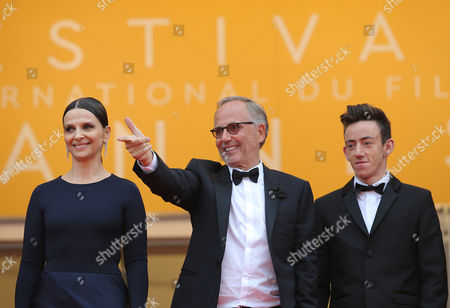 Actors Juliette Binoche, Fabrice Luchini and Brandon Lavieville from left, pose for photographers upon arrival at the screening of the film Ma Loute (Slack Bay) at the 69th international film festival, Cannes, southern France