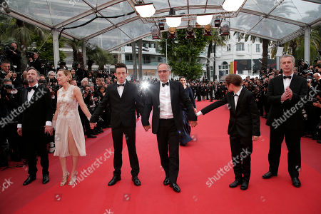 Actors from left, Jean-Luc Vincent, Valeria Bruni Tedeschi, Brandon Lavieville, Fabrice Luchini, Raph and director Bruno Dumont pose for photographers upon arrival at the screening of the film Ma Loute (Slack Bay) at the 69th international film festival, Cannes, southern France