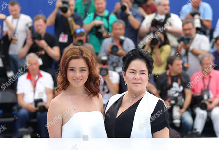 Actresses Andi Eigenmann, left and Jaclyn Jose pose for photographers during a photo call for the film Ma' Rosa at the 69th international film festival, Cannes, southern France