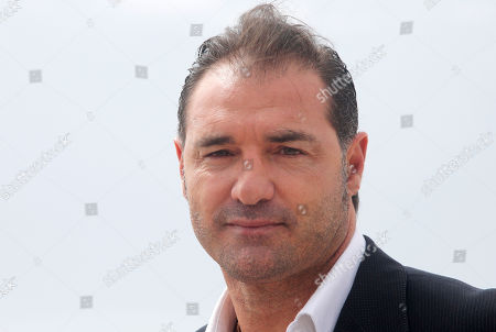 "Stock Photo of Retired Italian footballer Lorenzo Amoruso poses for photographers during the MIPTV, International Television Programme Market, in Cannes, southern France. He presents new tv reality format ""Football Nightmares"