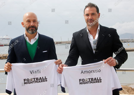 "Italian football manager and former footballer Gainluca Vialli, left, and retired Italian footballer Lorenzo Amoruso pose for photographers during the MIPTV, International Television Programme Market, in Cannes, southern France. They present new tv reality format ""Football Nightmares"