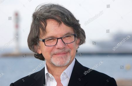 """American television writer and producer Frank Spotnitz poses for photographers during the MIPTV, International Television Programme Market, in Cannes, southern France. Frank Spotnitz presents TV series """"Medici: Masters of Florence"""